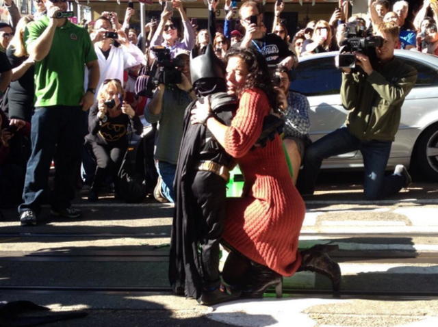 Batkid get a hug from the Woman who was rescued