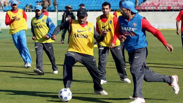 cricketer playing football